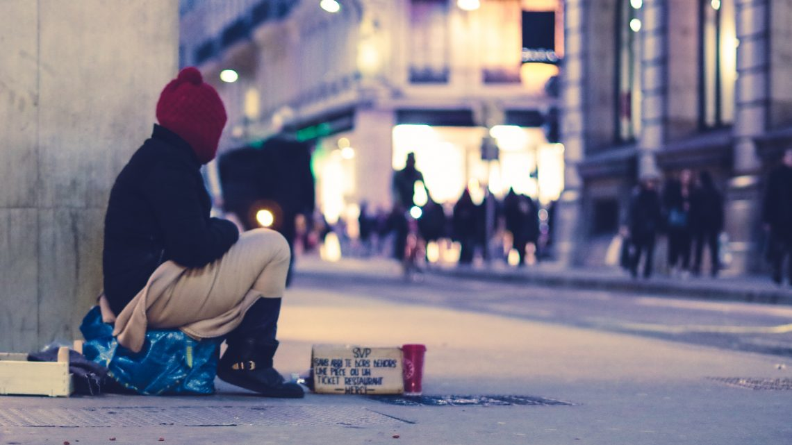 Homeless person sitting on the street